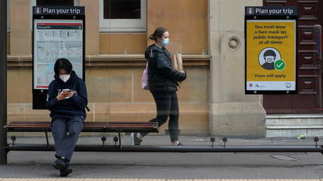 Australia to end emergency Covid income support as vaccine rates rise